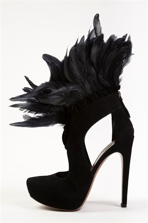 black high heel closed toe sandal with feather trim around ankle