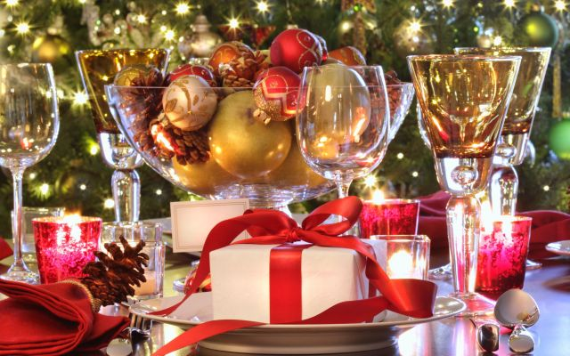 Elegant  holiday table setting with red ribboned gift