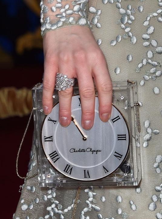 lily-james-cinderella charlotte olympia clock clutch